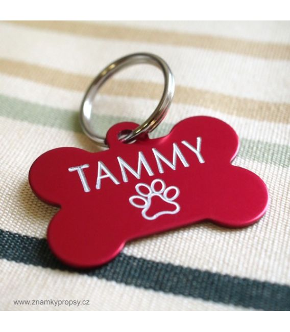 Red pet tag with engraving in bone shape